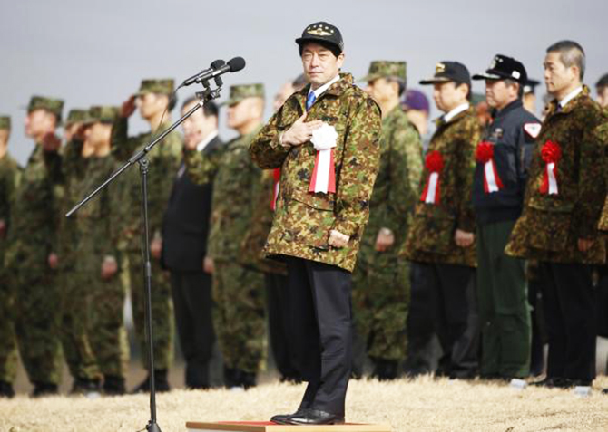 Japan's Defence Minister Itsunori Onodera (C) reviews troops during an annual new year military exercise at Narashino exercise field in Funabashi, east of Tokyo January 12, 2014.  Photo: Reuters
