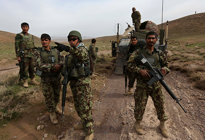 Afghan National Army soldiers (ANA) patrol at Nahr-e- Kanjak village at Adraskan district of Herat Province on Thursday. The Afghan presidential elections will be held on April 5. Photo: Reuters