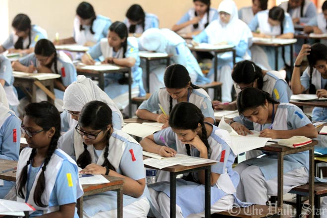 This Star file photo shows examinees from Viqarunnisa Noon School and College are taking part in JSC examination at Motijheel Ideal School and College centre in the capital.