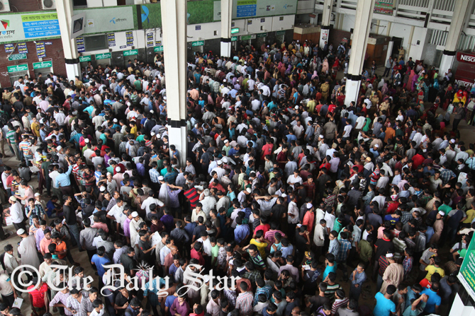 People stand in queues at Kamalapur Railway Station in the capital to get advance train tickets for going to their destinations ahead of Eid-ul-Fitr. The Bangladesh Railway authorities begin sale of advance train tickets Sunday. Photo: Anisur Rahman