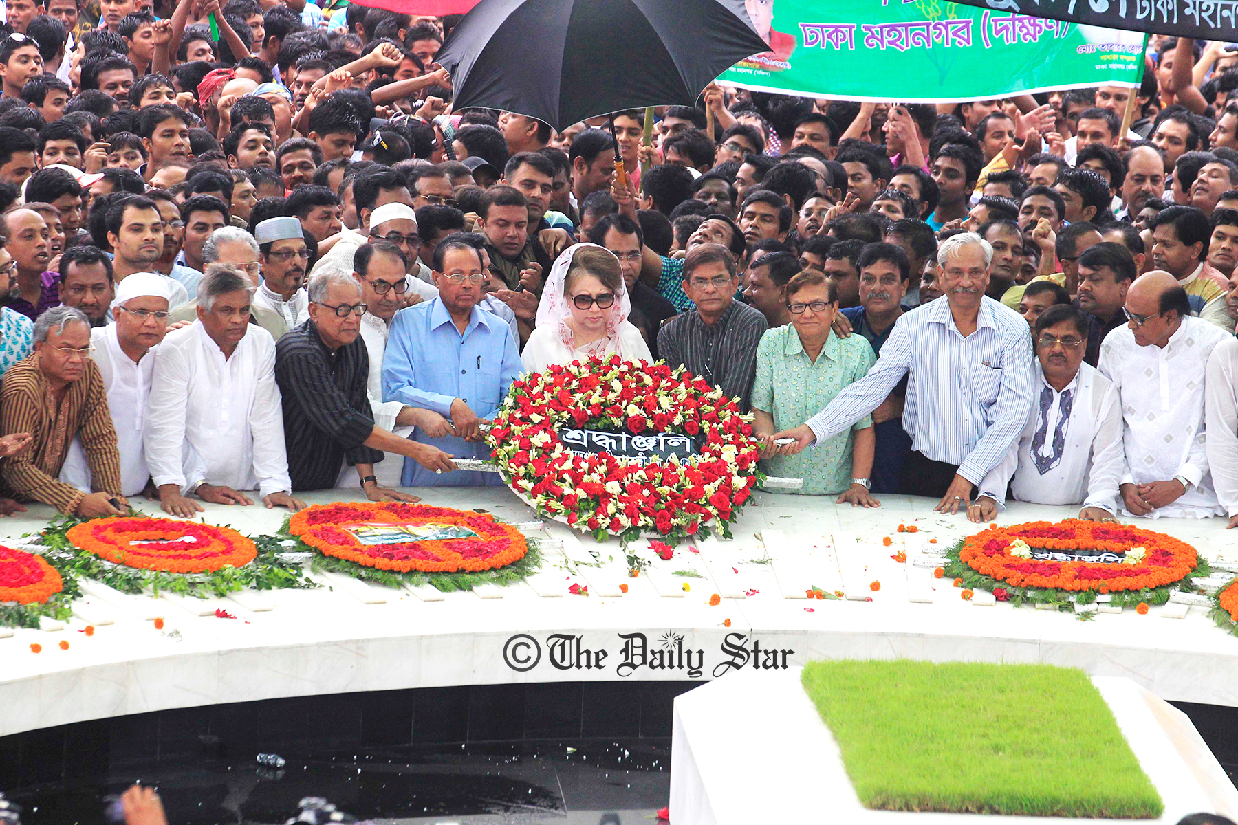 BNP Chairperson Khaleda Zia places a wreath at the grave of the party founder Ziaur Rahman marking his 33rd death anniversary at Sher-e-Bangla Nagar in the capital on Friday. Photo: Firoz Ahmed