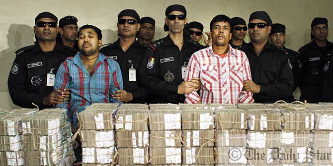 Rapid Action Battalion showcase retrieved money of Kishoreganj Sonali Bank heist at its headquarters in capital's Uttara on January 28. Photo: Star file