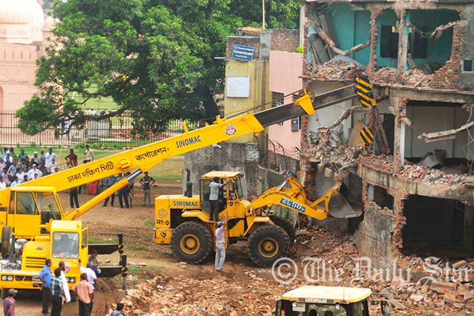 A bulldozer under the authority of Department of Archeology demolishes an illegal structure inside the historical Lalbagh Fort in Old Dhaka on Wednesday. Photo: Firoz Ahmed