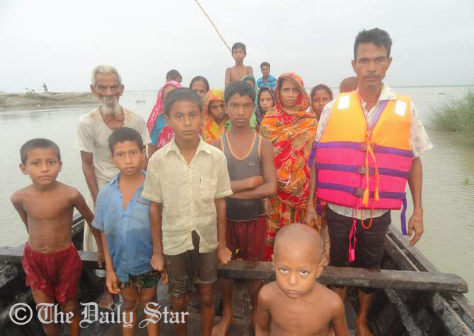 Flood-hit people are being shifted to safe place from Narsing Char village in Aditmari upazila of Lalmonirhat after their village goes under water of Teesta due to heavy rainfall and upstream. Photo: STAR