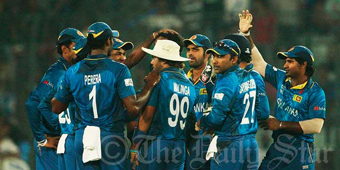 Sri Lanka celebrate another wicket as some brilliant bowling fromthe Lankans restricted India to 130 in the final of the World T20 in Mirpur on Sunday. Photo: Firoz Ahmed