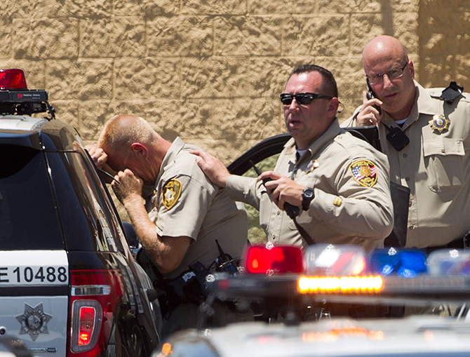 Metro Police officers are shown outside a Wal-Mart after a shooting in Las Vegas on June 8, 2014. Las Vegas police said on Sunday that a shooting incident involving officers resulted in injuries and urged people to stay away from the scene. Photo: Reuters