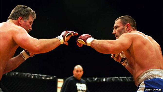 Dave Legeno (right) competed as a mixed martial arts fighter. Photo: Getty Images