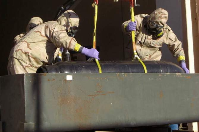 In an image from the Pentagon, a bomb was moved from a bunker in Libya to be later drained of its chemical agent. This photo was taken from The New York Times website.