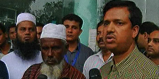 Mohammad Azharul Haque (R), joint secretary of Expatriates' Welfare and Overseas Employment ministry, talks to the reporters on Friday after handing over the bodies of two brothers, to their father (L), who died in Libya missile attack. Photo: TV grab