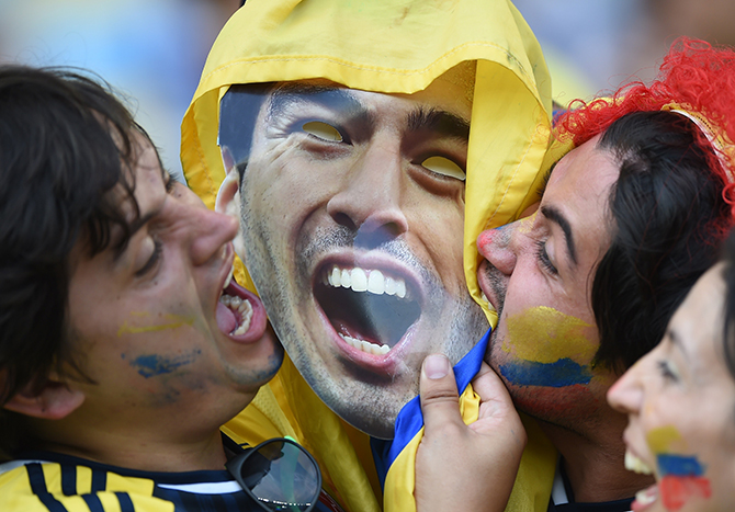 Fans cheer kiss a cardboard cut outs of Uruguayan forward Luis Suarez prior to the Round of 16 football match between Colombia and Uruguay at the Maracana Stadium in Rio de Janeiro during the 2014 FIFA World Cup in Brazil on June 28. Photo: Getty Images