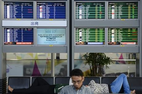 "An electronic board displaying ""Pray for MH17"" at the departure hall at Kuala Lumpur International Airport in Sepang, Malaysia, Friday, July 18, 2014. Photo: AP"