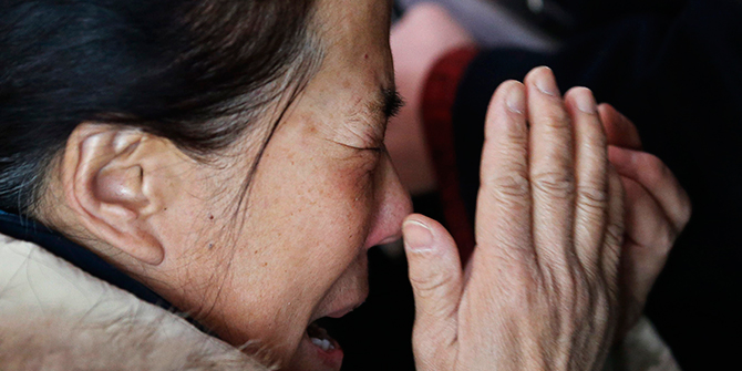 A woman (C), believed to be the relative of a passenger onboard Malaysia Airlines flight MH370, covers her face as she cries at the Beijing Capital International Airport in Beijing on March 8, 2014. Photo: Reuters A woman (C), believed to be the relative of a passenger onboard Malaysia Airlines flight MH370, covers her face as she cries at the Beijing Capital International Airport in Beijing on March 8, 2014. Photo: Reuters
