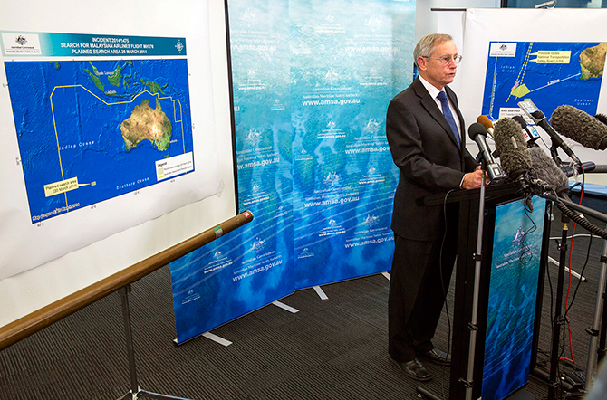 John Young, general manager of the emergency response division of the Australian Maritime Safety Authority (AMSA), answers a question as he stands in front of a diagram showing the search area for Malaysia Airlines Flight MH370 in the southern Indian Ocean, during a briefing in Canberra on March 20. Photo: Reuters