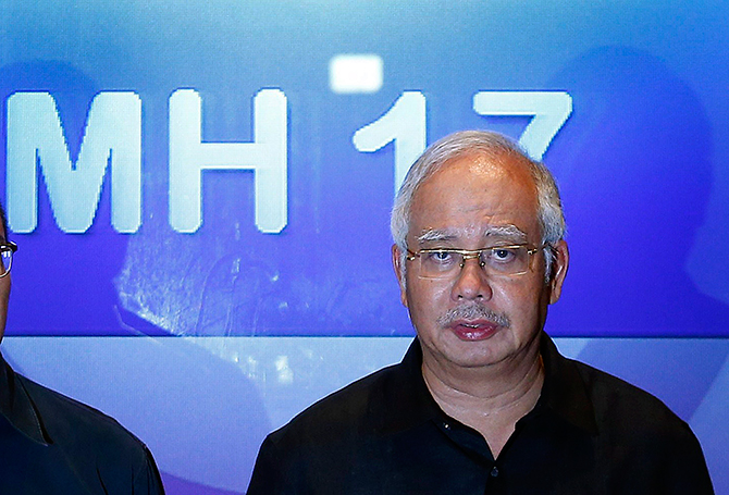 Malaysian Prime Minister Najib Razak addresses reporters at the Sama-Sama Hotel near Kuala Lumpur International Airport in Sepang July 18, 2014. Razak demanded swift justice for those responsible if Malaysia Airlines flight MH-17 that came down in Ukraine was found to have been shot down. Photo: Reuters