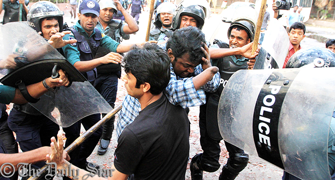 Police detain the activists of Gonojagoron Mancha from Shahbagh in the capital this afternoon. Photo: Palash Khan