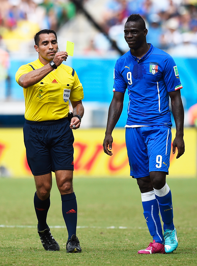 Mario Balotelli of Italy receives an yellow card by referee Marco Rodriguez during the 2014 FIFA World Cup Brazil Group D match between Italy and Uruguay at Estadio das Dunas on June 24, 2014 in Natal, Brazil. Photo: Getty Images