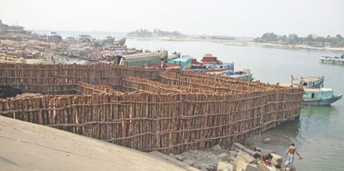 This under construction base meant for landing of heavy equipment for Ashuganj Power Station Company Ltd will now be reduced by 20 feet towards the bank of the Meghna River to ensure smooth navigability of the important waterway. PHOTO: STAR