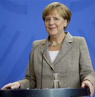 German Chancellor Angela Merkel smiles during a joint news conference with the Prime Minster of Moldova Iurie Leanca as part of a meeting at the chancellery in Berlin, Germany, Thursday, July 10. Photo: AP