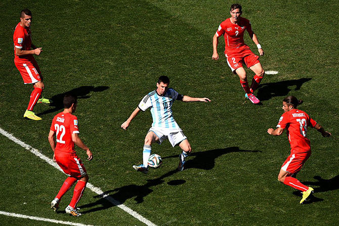 Lionel Messi of Argentina controls the ball against Josip Drmic (L), Fabian Schar (2nd L), Stephan Lichtsteiner (2nd R) and Ricardo Rodriguez of Switzerland during the 2014 FIFA World Cup Brazil Round of 16 match between Argentina and Switzerland. Photo: Getty Images