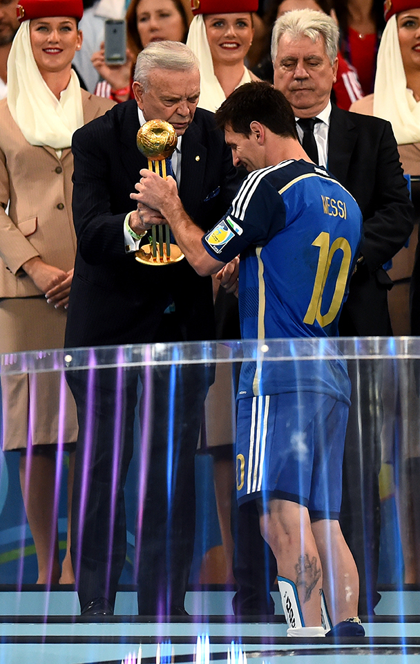 Jose Maria Marin, President of the CBF, presents Lionel Messi of Argentina with the Golden Ball during the award ceremony of the 2014 FIFA World Cup Brazil Final match between Germany and Argentina at Maracana on July 13, 2014 in Rio de Janeiro, Brazil. Photo: Getty Images