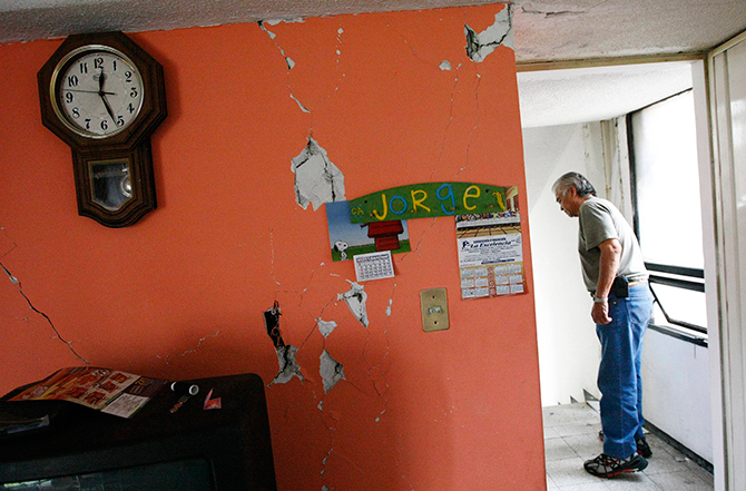 A man inspects the damage in his apartment following an earthquake in Mexico City on Friday. Photo: Reuters