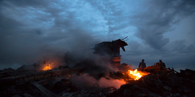 People walk amongst the debris at the crash site of a passenger plane near the village of Grabovo, Ukraine, on July 17, 2014. Photo: AP