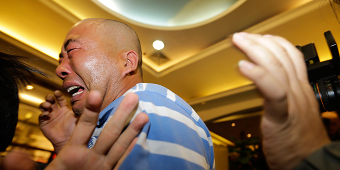 Relatives of passengers aboard Malaysia Airlines MH370 cry after watching a television broadcast of a news conference, in the Lido hotel in Beijing on Monday. Malaysian Prime Minister Najib Razak has told families of passengers of a missing Malaysian airliner that the plane ended its journey in the southern Indian Ocean. Photo: Reuters