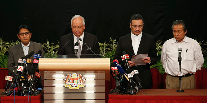 Malaysia's Prime Minister Najib Razak (2nd L) makes an announcement on the latest development on the missing Malaysia Airlines MH370 plane at Putra World Trade Center in Kuala Lumpur on Monday. Photo: Reuters