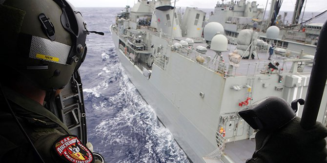 Leading Seaman Aircrewman Joel Young looks out from Tiger75, an S-70B-2 Seahawk helicopter, after it launched from the Australian Navy ship the HMAS Toowoomba as it continues the search in the southern Indian Ocean for the missing Malaysian Airlines flight MH370, in this picture released by the Australian Defence Force on Friday. Photo: Reuters