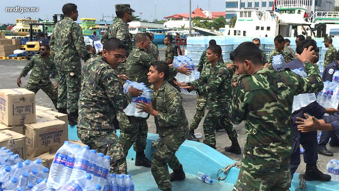 Maldives military distributing water supplies in the crisis hit capital Male. Photo: Minivan News