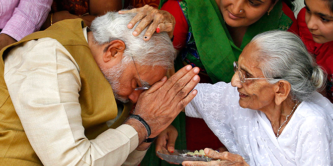 Hindu nationalist Narendra Modi (L), the prime ministerial candidate for India's main opposition Bharatiya Janata Party (BJP), seeks blessings from his mother Heeraben at her residence in Gandhinagar in the western Indian state of Gujarat on Friday. Modi will be the next prime minister of India, with counting trends showing the pro-business Hindu nationalist and his party headed for the most resounding election victory the country has seen in thirty years. Photo: Reuters