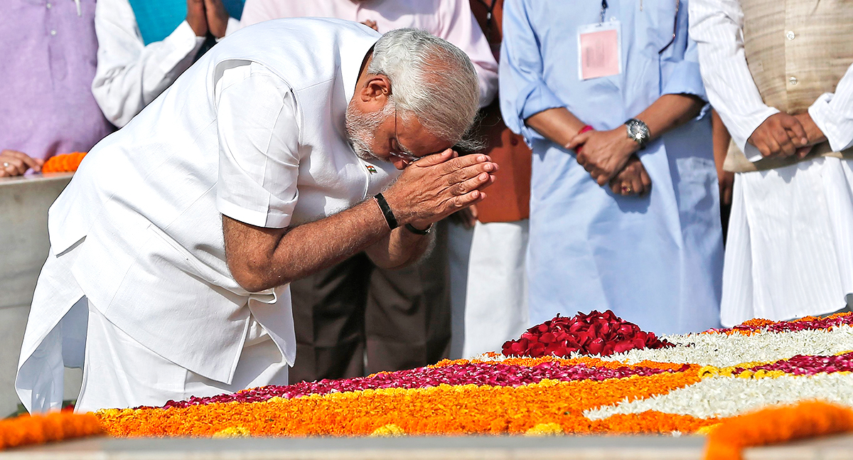 Indian Prime Minister-designate Narendra Modi pays his respects at the Mahatma Gandhi memorial at Rajghat ahead of his swearing-in ceremony, in New Delhi Monday. Photo: Reuters