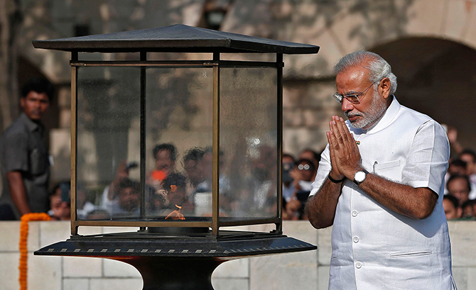 Indian Prime Minister-designate Narendra Modi walks at the Mahatma Gandhi memorial after paying the flower tribute at Rajghat ahead of his swearing-in ceremony, in New Delhi on Monday. Photo: Reuters