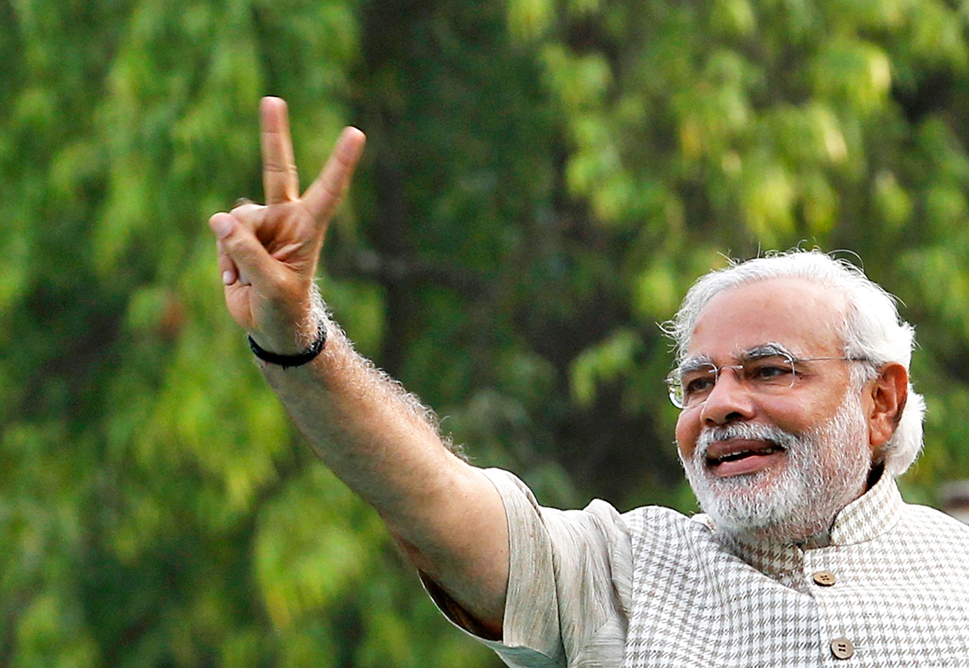 Hindu nationalist Narendra Modi, the prime ministerial candidate for India's main opposition Bharatiya Janata Party (BJP), gestures during a public meeting in Vadodra, in the western Indian state of Gujarat May 16, 2014. Photo: Reuters