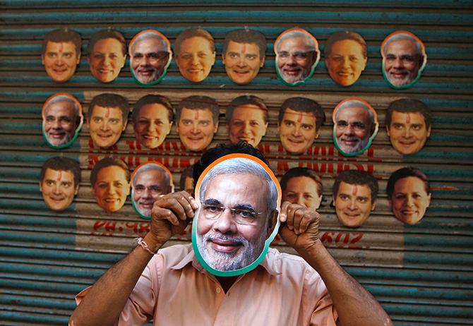 This Reuters photo taken on April 3, 2014 shows a vendor wearing a mask of Hindu nationalist Narendra Modi, prime ministerial candidate for main opposition Bharatiya Janata Party (BJP) and Gujarat's chief minister, to attract customers at his stall selling masks of Indian political leaders ahead of general election in the southern Indian city of Chennai. Photo: Reuters