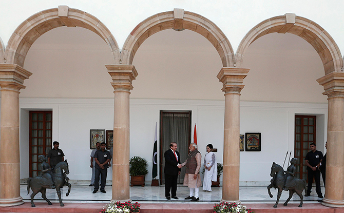 India's Prime Minister Narendra Modi (centre R) shakes hands with his Pakistani counterpart Nawaz Sharif (centre L) before the start of their bilateral meeting in New Delhi on Tuesday. Photo: Reuters