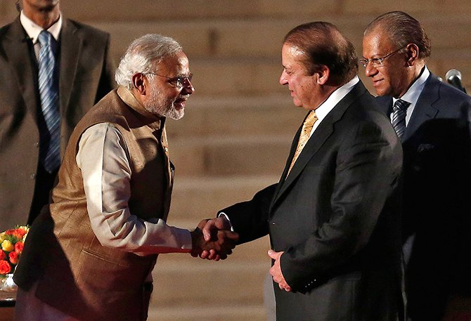 India's Prime Minister Narendra Modi (L) is greeted by his Pakistani counterpart Nawaz Sharif after Modi took the oath of office at the presidential palace in New Delhi on Monday. Photo: Reuters