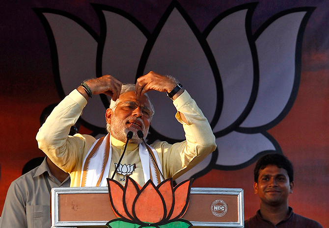 Hindu nationalist Narendra Modi, the prime ministerial candidate for India's main opposition Bharatiya Janata Party (BJP), gestures as he addresses an election campaign rally in Barasat, north of Kolkata May 7, 2014. Photo: Reuters