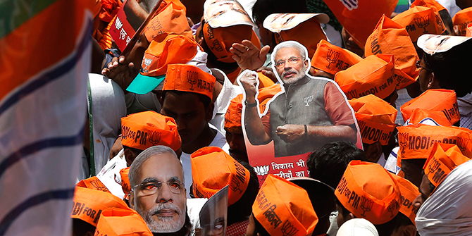 A supporter of Hindu nationalist Narendra Modi, prime ministerial candidate for India's main opposition Bharatiya Janata Party (BJP), carries a cut-out as they wait for Modi's arrival to file nomination papers for the general elections in the northern Indian city of Varanasi on Thursday. Photo: Reuters
