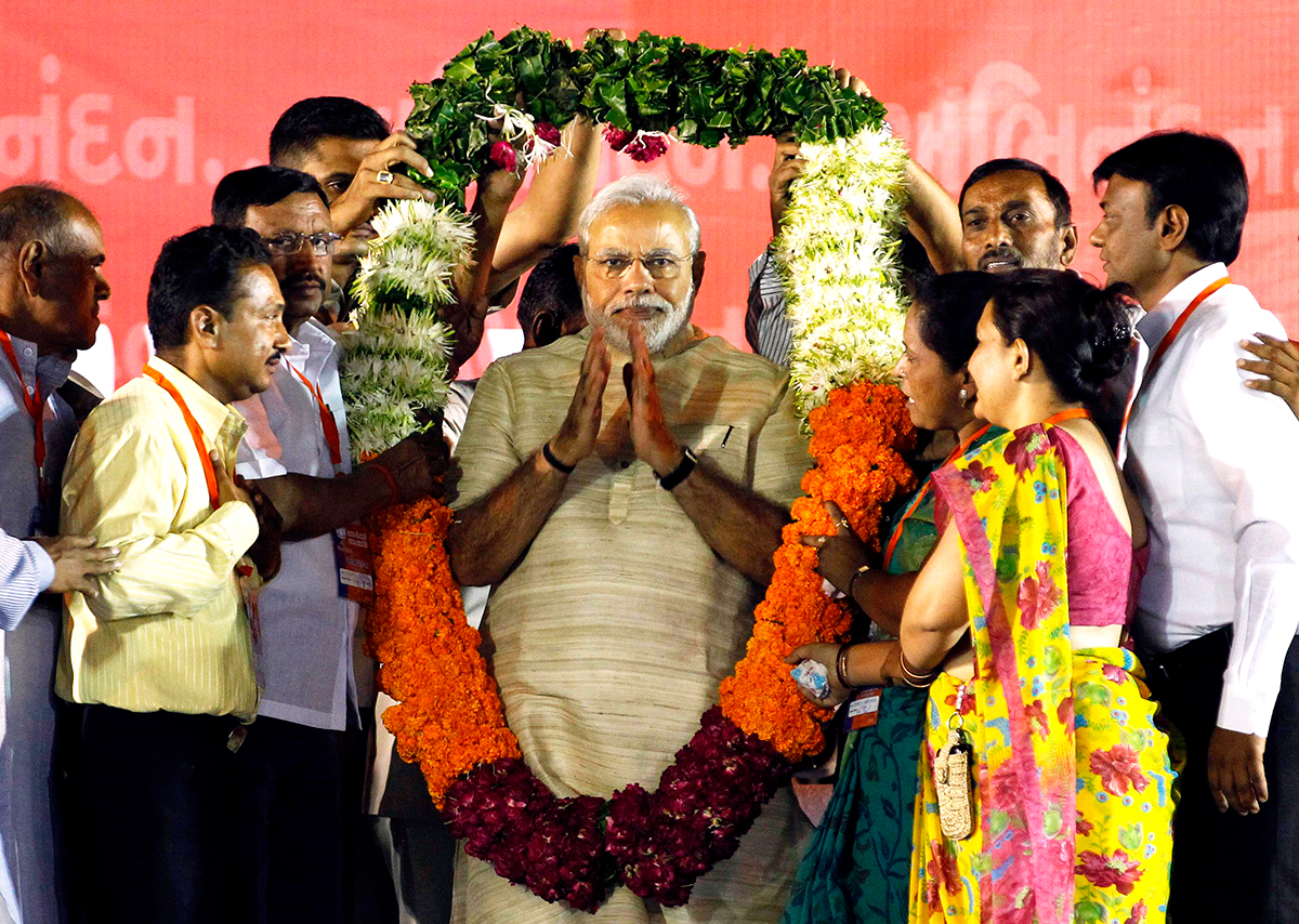 Hindu nationalist Narendra Modi, who will be the next prime minister of India, wears a garland presented to him by his supporters at a public meeting in the western Indian city of Ahmedabad May 20, 2014. Photo: Reuters