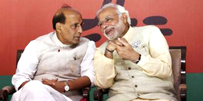 Hindu nationalist Narendra Modi (R), the prime ministerial candidate for India's main opposition Bharatiya Janata Party (BJP), speaks with his party's president Rajnath Singh before releasing their election manifesto in New Delhi April 7, 2014. Photo: Reuters
