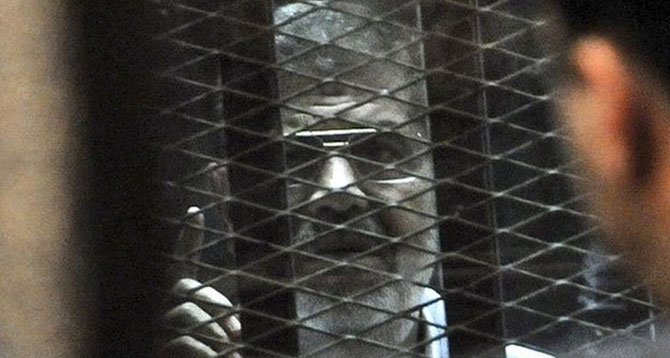 Morsi was held in a glassed-in cage for his last court appearance. Photo: AP