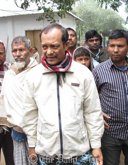 Law enforcers (not seen) take Jeweller Mridul Kumar Chowdhury from Devpur Police Outpost to Chittagong this morning. Six days after his abduction a night guard found Mridul alive at Kangshanagar Bazar in Burichang upazila of Comilla. Photo: Star
