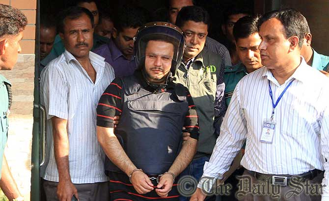 Criminal Investigation Department of police produce Nazmul Maksud Murad to the press today at capital's CID Headquarters. Photo: Palash Khan