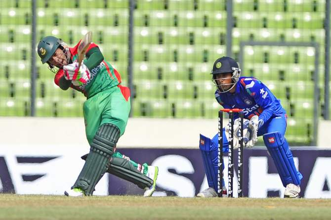 Skipper Mushfiqur drives the ball on his way to half-century at Mirpur stadium before he departs at his 59 off 63 balls in the first match of ODI of three-match series against India on Sunday. Photo: Firoz Ahmed