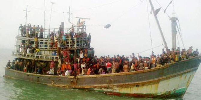 Bangladesh Coast Guard brings back a Malaysia-bound trawler to the St Martin Island's after rescuing it 12 kilometers off the island in south-east Bay of Bengal on Wednesday. Traffickers shot dead five people and injure at least 151 on board among 330 people who were being taken illegally to Malaysia. Photo: Banglar Chokh