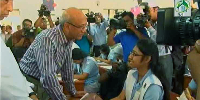 Education Minister Nurul Islam Nahid talks with an HSC examinee during his visit to an examination centre in the capital on Thursday morning. Photo: TV grab