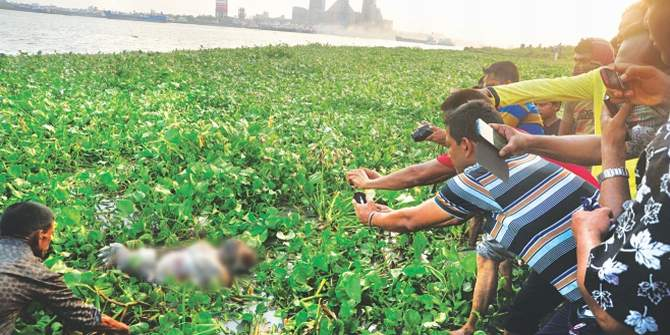 This April 30 photo shows one of the seven bodies found on the river Shitalakkhya in Narayanganj is being pulled towards the shore. The photo was partly pixelated. Photo: Courtesy/TV grab