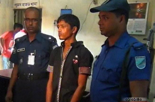 Policemen produce a man who knifed his wife and daughter to death in Narayanganj before reporters on Saturday.  Photo: TV grab