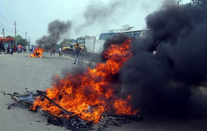 This April 28 Banglar Chokh photo shows a burning tyre set fire by locals on Dhaka-Chittagong highway in Narayanganj. Locals block the highway protesting what they said abduction of five people including a ward councilor of Narayanganj City Corporation.